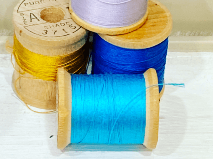 Spools of thread used in production pattern making.